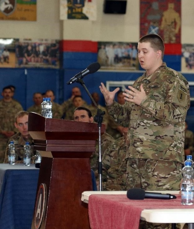 Retired Army Spc. Matt Stubblefield, formerly with D company, 1-26 Blue Spaders, 1st Infantry Division, tells troops how an improvised explosive device lead to his leg amputation, during a Operation Proper Exit town hall meeting, March 14 at Camp Arifjan, Kuwait. As a U.S. Army Veteran with Operation Proper Exit, Stubblefield will have an opportunity to return to the area where he was injured and depart on his own terms.
