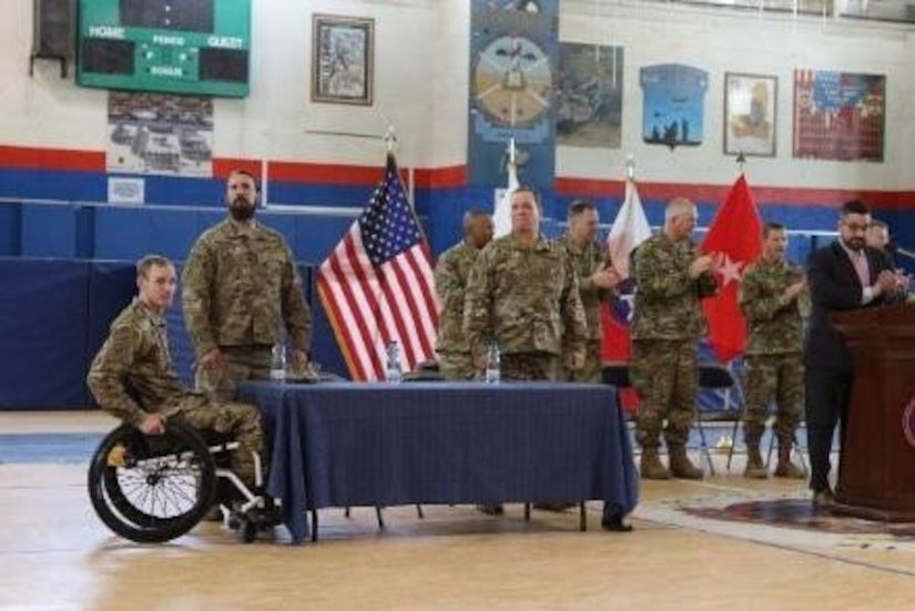 Soldiers of Operation Proper Exit are introduced in a town hall meeting, March 14, 2017, at Camp Arifjan, Kuwait. These U.S. Army Veterans are given a chance to return to the battlefield and depart on their own terms, which is an important part of heeling.