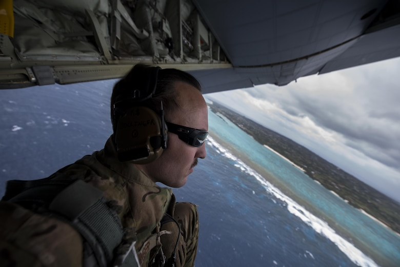 U.S. Air Force Tech. Sgt. Kade Bollinger, 17th Special Operations Squadron MC-130J Commando II instructor loadmaster, observes the horizon during a training sortie March 21, 2017, off the coast of Okinawa, Japan. Bollinger conducted low altitude flight training with Brig. Gen. Barry Cornish, 18th Wing commander, to give him a first-hand insight into the capabilities of the 17th SOS and 353rd Special Operations Group. (U.S. Air Force photo by Airman 1st Class Corey Pettis)