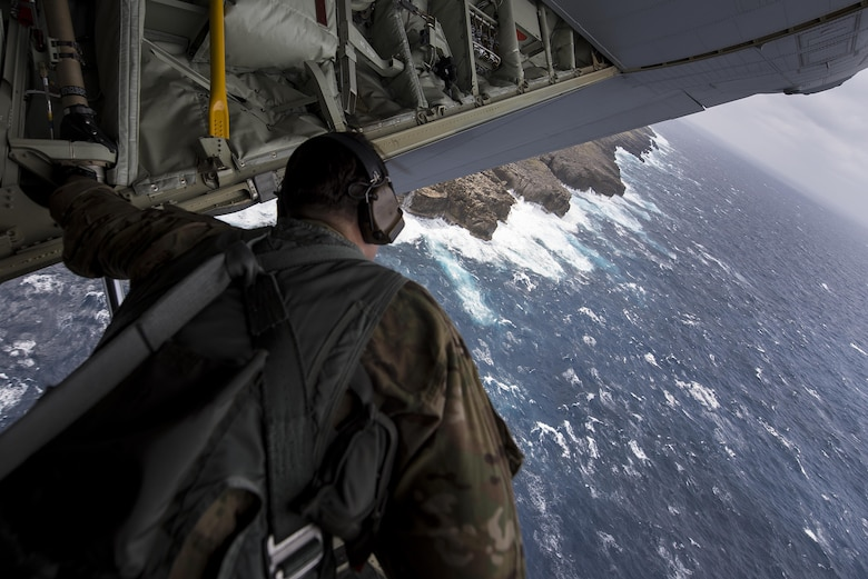 U.S. Air Force Tech. Sgt. Kade Bollinger, 17th Special Operations Squadron MC-130J Commando II instructor loadmaster, observes the water during a training sortie March 21, 2017, off the coast of Okinawa, Japan. Bollinger conducted low altitude training with Brig. Gen. Barry Cornish, 18th Wing commander, so he could experience the combat flight capabilities of the MC-130J and its aircrew. (U.S. Air Force photo by Airman 1st Class Corey Pettis)