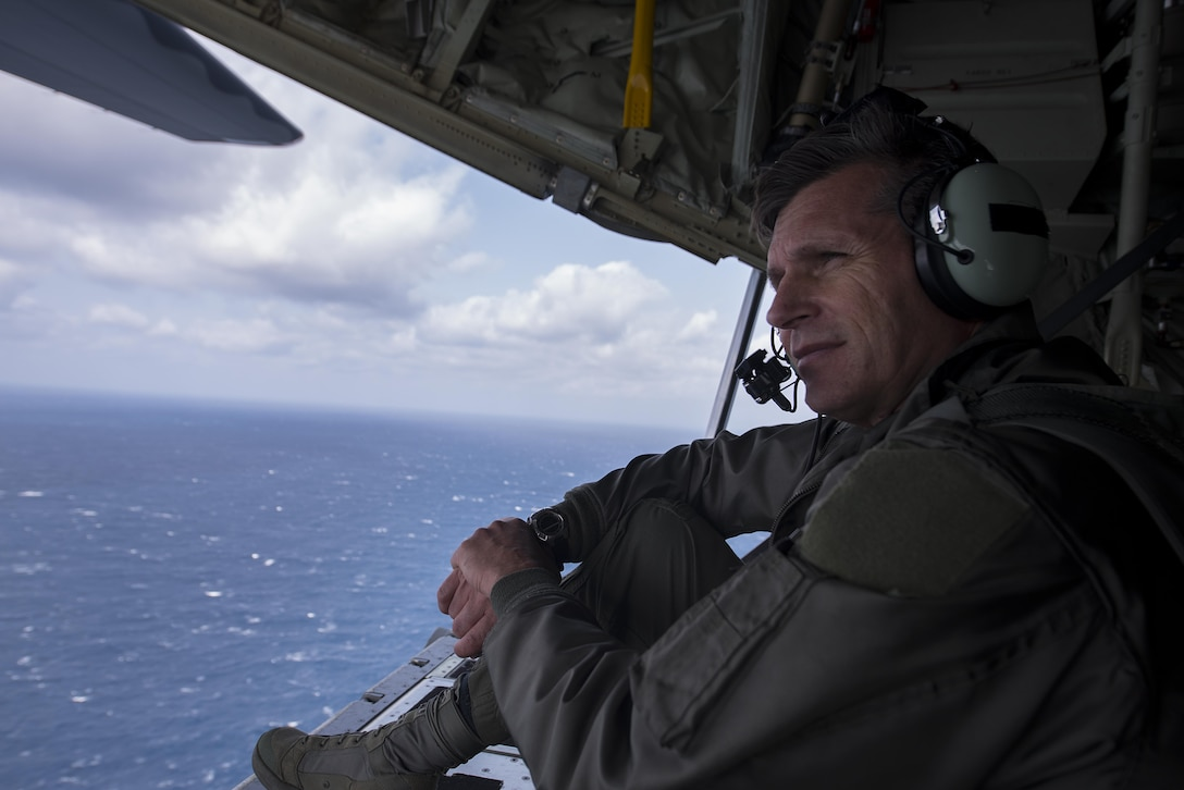 U.S. Air Force Brig. Gen. Barry Cornish, 18th Wing commander, observes the horizon from the cargo bay of a 17th Special Operations Squadron MC-130J Commando II cargo plane during a training sortie March 21, 2017, off the coast of Okinawa, Japan. Cornish conducted low altitude flight training with the 17th SOS to experience first-hand the tactical capabilities of the MC-130J and to better understand the unit's interoperability with the 18th Wing. (U.S. Air Force photo by Airman 1st Class Corey Pettis)
