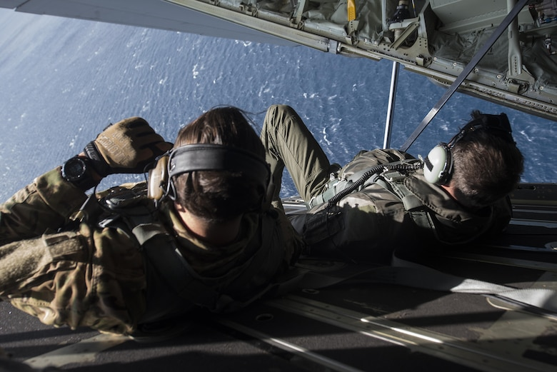 U.S. Air Force Brig. Gen. Barry Cornish, 18th Wing commander, and Tech. Sgt. Kade Bollinger, 17th Special Operations Squadron MC-130J Commando II instructor loadmaster, lay down on a cargo bay door for low altitude flight maneuvers during a training sortie March 21, 2017, off the coast of Okinawa, Japan. Cornish flew with Bollinger and other 17th SOS Airmen to experience first-hand the combat capabilities of the MC-130J and its aircrew. (U.S. Air Force photo by Airman 1st Class Corey Pettis)
