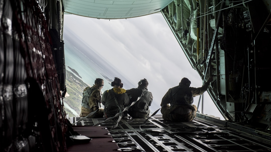18th Wing Shogun Airmen observe the horizon from the cargo bay door of a 17th Special Operations Squadron MC-130J Commando II during a training sortie March 21, 2017, off the coast of Okinawa, Japan. Brig. Gen. Barry Cornish flew with the 17th SOS to better understand combat capabilities of the MC-130J and aircrews. (U.S. Air Force photo by Staff Sgt. Peter Reft)