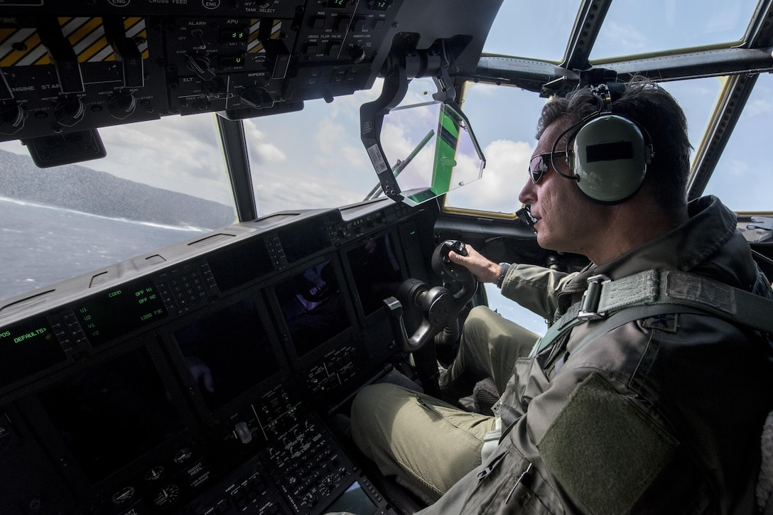 U.S. Air Force Brig. Gen. Barry Cornish, 18th Wing commander, conducts low altitude flight maneuvers in a 17th Special Operations Squadron MC-130J Commando II March 21, 2017, off the coast of Okinawa. Brig. Gen. Cornish flew with the 17th SOS to better understand the strategic and tactical capabilities of the MC-130J as well as the 353rd Special Operations Group interoperability with allied forces across the Indo-Asia Pacific Theater. (U.S. Air Force photo by Staff Sgt. Peter Reft) (This photo has been manipulated by removing cockpit display information)
