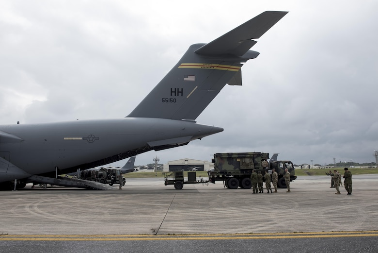 Japan Ground Self-Defense Force members observe Soldiers of the 1st Battalion, 1st Air Defense Artillery Regiment load Patriot missile battery equipment onto a C-17 Globe Master III March 14, 2017, on Kadena Air Base, Japan. The Patriot missile system is a long-range air defense asset and can be broken down to be transported via plane anywhere in the world in a matter of hours. (U.S. Air Force photo by Senior Airman Omari Bernard)