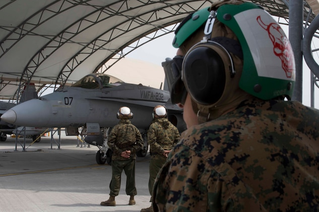 U.S. Marines with Marine Attack Squadron (VMFA) 232 wait for the pilot of an F/A-18C Hornet aircraft to prepare for takeoff at Marine Corps Air Station (MCAS) Iwakuni, Japan, March 22, 2017. The squadron left MCAS Miramar, Calif., March 11, 2017, and arrived at MCAS Iwakuni March 15. The squadron is part of the Unit Deployment Program and helps provide air support to III Marine Expeditionary Force through training and combat operations. (U.S. Marine Corps photo by Lance Cpl. Gabriela Garcia-Herrera)