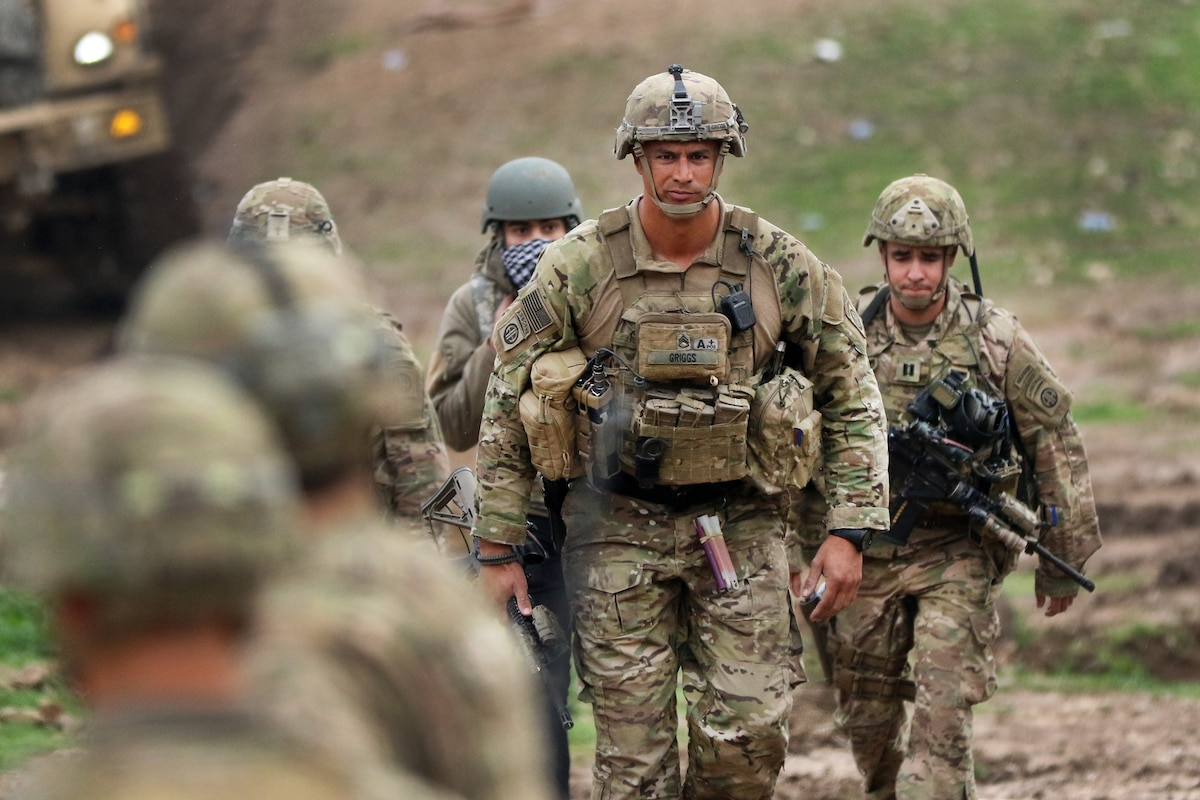 U.S. soldiers walk during a mission.