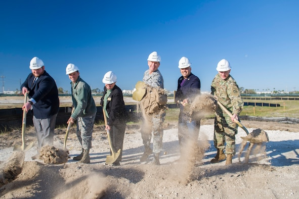 (From left to right) Thomas Self, Senator Marco Rubio's regional director for the Central Florida region; Col. Burton Catledge, 45th Operations Group commander; Barbara Arthur, Senator Bill Nelson's regional director; Brig. Gen. Wayne Monteith, 45th Space Wing commander; Rob Medina, Congressman Bill Posey's director of community and military relations; and Lt. Col. Landon Raby, U.S. Army Corps of Engineers Mobile District deputy commander, dig in during a groundbreaking ceremony for the new Range Communications Facility March 16, 2017, at Cape Canaveral Air Force Station, Fla. The new $18.6 million facility is slated to be a 32,314-square-foot facility, replacing the former XY building and is scheduled for completion in 2018. (U.S. Air Force photo/Matthew Jurgens)