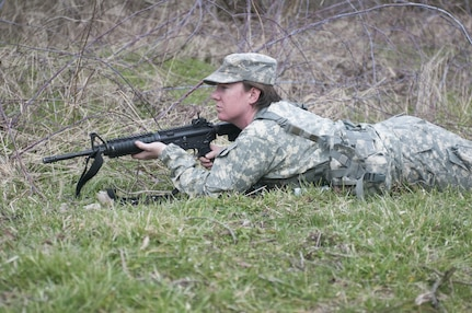 U.S. Army Reserve Sgt. Kristin Welch, with the 303rd Psychological Operations Company, pulls rear security Saturday, March 25, 2017, during a unit field exercise in Pennsylvania. She is a full time student pursuing a graduate degree in Art History.