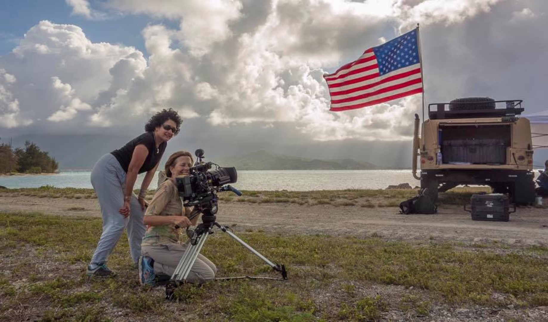 Nutan Chada (left) poses for a photo with a cameraperson after a video shoot in Kane'ohe Bay, Hawaii.