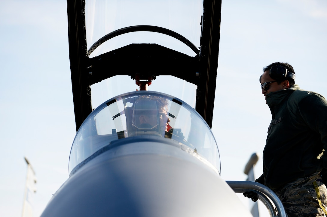 An F-15C Eagle pilot talks with his crew chief after landing at Leeuwarden Air Base, Netherlands, March 24, 2017. F-15C's from the Lousiana and Florida Air National Guard's 159th Expeditionary Fighter Squadron deployed to Europe to participate in a Theater Security Package. These F-15s will conduct training alongside NATO allies to strengthen interoperability and to demonstrate U.S. commitment to the security and stability of Europe. (U.S. Air Force photo by Tech. Sgt. Staci Miller)