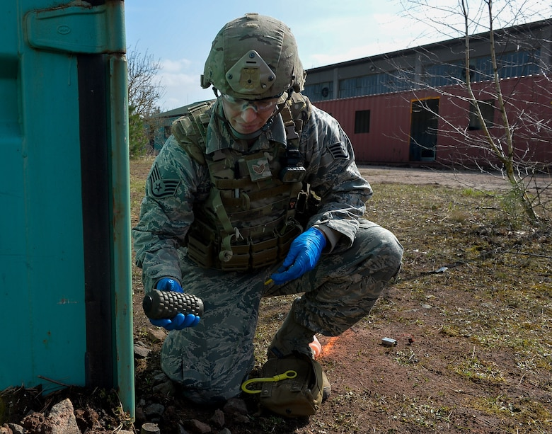 Staff. Sgt. Sam Reardon Staff Sgt. Sam Reardon, 52nd Civil Engineer Squadron explosive ordnance disposal craftsman, holds a mock explosive after neutralizing it during an exercise on Ramstein Air Base, Germany, March 23, 2017. The event took place at a newly established training ground, which featured a mock-village where various scenarios can occur. Exercise Silver Flag, which includes the EOD training, takes place more than once a year. (U.S. Air Force photo by Airman 1st Class Joshua Magbanua)