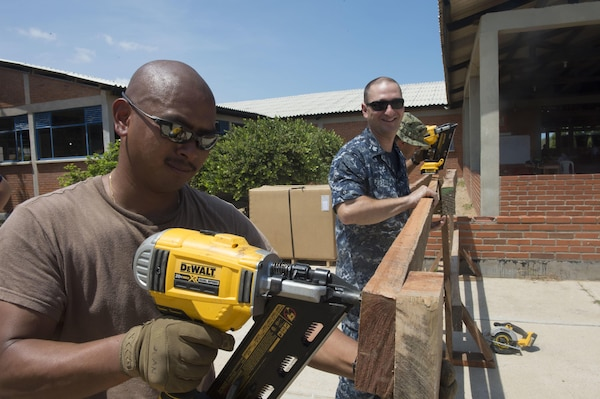 Construction Electrician 2nd Class JanRainer San Juan, a native of Fountain, Colo., assigned to Construction Battalion Maintenance, Norfolk, Va., builds a barricade for medical operations at a medical site in support of Continuing Promise 2017 (CP-17) in Mayapo, Colombia. CP-17 is a U.S. Southern Command-sponsored and U.S. Naval Forces Southern Command/U.S. 4th Fleet-conducted deployment to conduct civil-military operations including humanitarian assistance, training engagements, medical, dental, and veterinary support in an effort to show U.S. support and commitment to Central and South America. (U.S. Navy Combat Camera photo by Mass Communication Specialist 2nd Class Ridge Leoni)