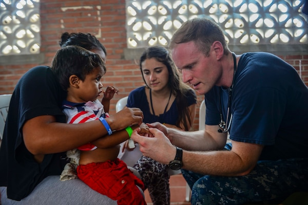 MAYAPO, Colombia (March 24, 2017) - Lt. Andrew Smith, a native of Richmond, Va., assigned to Naval Hospital Jacksonville, Fla., examines a host nation patient at the Continuing Promise 2017 (CP-17) medical site in Mayapo, Colombia. CP-17 is a U.S. Southern Command-sponsored and U.S. Naval Forces Southern Command/U.S. 4th Fleet-conducted deployment to conduct civil-military operations including humanitarian assistance, training engagements, and medical, dental, and veterinary support in an effort to show U.S. support and commitment to Central and South America. (U.S. Navy Combat Camera photo by Mass Communication Specialist 2nd Class Brittney Cannady)