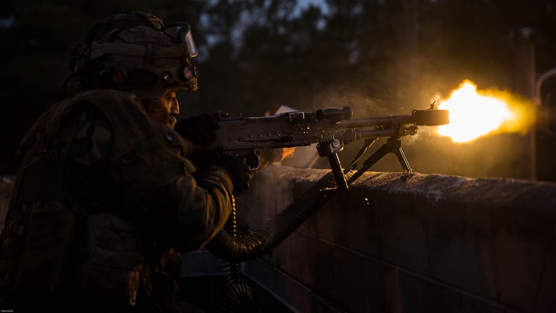 A Dutch Marine provides suppressive fire with a M240B machine gun while training with U.S. Marines with 2nd Reconnaissance Battalion, 2nd Marine Division, during a Military Operation in Urban Terrain exercise at Marine Corps Base Camp Lejeune, N.C., March 23, 2017. During the integrated training exercise, Dutch and U.S. Marines worked with canine units, coordinated air assets and exchanged tactics between services in order to strengthen cohesion and interoperability between the partner two allied nations.