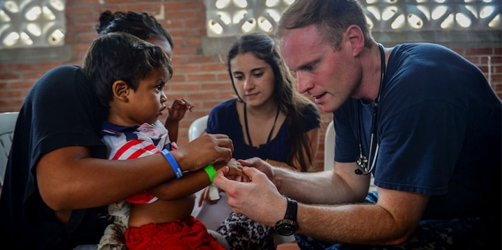 MAYAPO, Colombia (March 24, 2017) - Lt. Andrew Smith, a native of Richmond, Va., assigned to Naval Hospital Jacksonville, Fla., examines a host nation patient at the Continuing Promise 2017 (CP-17) medical site in Mayapo, Colombia. (U.S. Navy Combat Camera photo by Mass Communication Specialist 2nd Class Brittney Cannady)