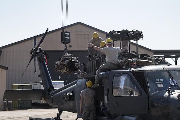 Airmen from the 41st Helicopter Maintenance Unit install an engine onto a HH-60G Pave Hawk, March 22, 2017, at Moody Air Force Base, Ga. The 41st HMU is responsible for Moody's Pave Hawk fleet. Through innovation and preventative maintenance, they ensure each of their 13 Pave Hawks receive the upkeep needed to accomplish the mission. (U.S. Air Force photo by Airman 1st Class Janiqua P. Robinson)