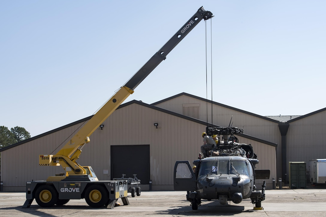 Airmen from the 41st Helicopter Maintenance Unit install an engine to a HH-60G Pave Hawk, March 22, 2017, at Moody Air Force Base, Ga. The 41st HMU is responsible for Moody's Pave Hawk fleet. Through innovation and preventative maintenance, they ensure each of their 13 Pave Hawks receive the upkeep needed to accomplish the mission. (U.S. Air Force photo by Airman 1st Class Janiqua P. Robinson)