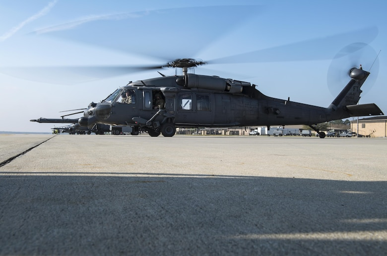 An HH-60G Pave Hawk fires up near the flightline while Airmen perform a preflight systems check, March 22, 2017, at Moody Air Force Base, Ga. The 41st HMU is responsible for Moody's Pave Hawk fleet. Through innovation and preventative maintenance, they ensure each of their 13 Pave Hawks receive the upkeep needed to accomplish the mission. (U.S. Air Force photo by Airman 1st Class Janiqua P. Robinson)