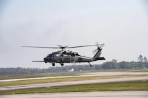 An HH-60G Pave Hawk hovers near the flightline, March 22, 2017, at Moody Air Force Base, Ga. The 41st HMU is responsible for Moody's Pave Hawk fleet. Through innovation and preventative maintenance, they ensure each of their 13 Pave Hawks receive the upkeep needed to accomplish the mission. (U.S. Air Force photo by Airman 1st Class Janiqua P. Robinson)