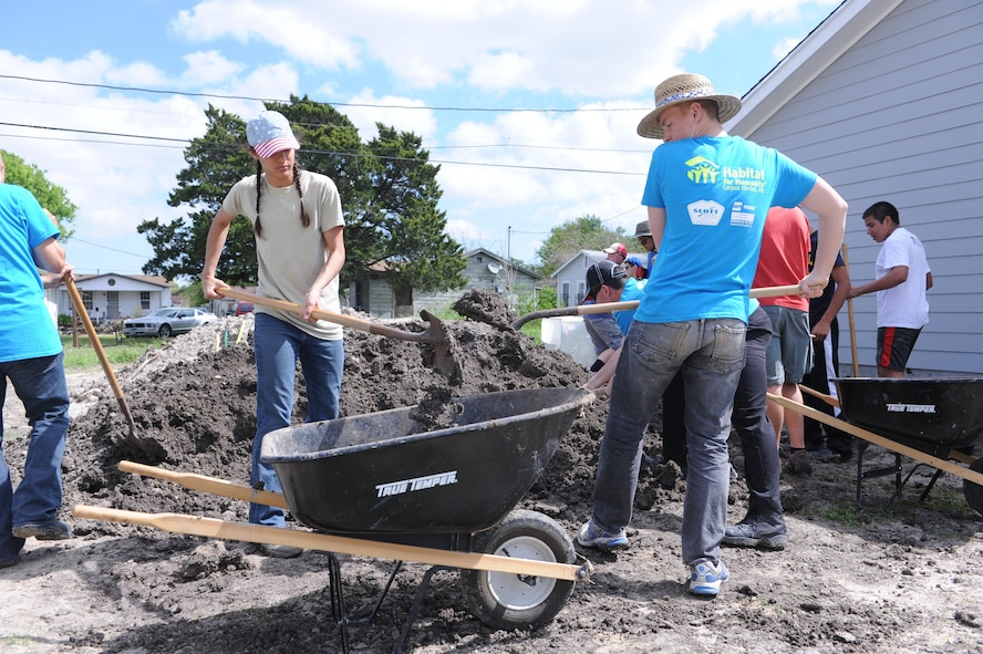 Then-Cadet 2nd Class Leah Gates (left) and then-Cadet 4th Class Luke Robinson shovel dirt into a wheelbarrow  in Corpus Christi, Texas, March 22, 2016, during an Alternate Spring Break Program volunteer effort with Habitat for Humanity. (Air Force photo/John Van Winkle)