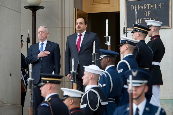 Defense Secretary Jim Mattis, left, and Qatari Defense Minister Khalid bin Mohammed al-Attiyah render honors during the playing of U.S. and Qatari national anthems at the Pentagon, March 27, 2017. DoD photo by Air Force Tech. Sgt. Brigitte N. Brantley