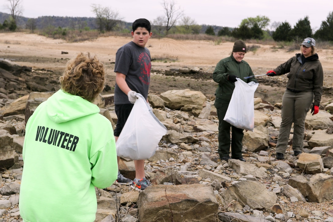 Volunteers pick up trash at Lake Eufaula as part of the bi-annual cleanup effort by the local organization Team Up to Clean Up.