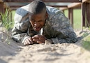 Army Reserve Spc. Michael Parrish Jr., a Petersburg, Virg. native and human resources specialist with Alpha Company, 2-319th, 104th Training Division (LT), completes the low-crawl obstacle during the 108th Training Command (IET) Best Warrior Competition at Camp Bullis, Texas, March 19-24, 2017. Parrish earned the title of 2017 Soldier of the Year for the 104th Training Division (LT).  (U.S. Army Reserve photo by Maj. Michelle Lunato.)