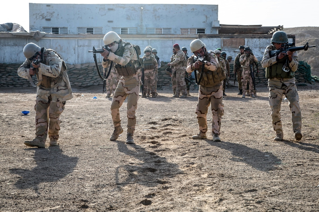 Iraqi security forces soldiers practice patrolling during urban assault training at Camp Manion, Iraq, March 21, 2017. Coalition forces train ISF basic combat skills to increase success on the battlefield in support of Combined Joint Task Force – Operation Inherent Resolve, the global Coalition to defeat ISIS in Iraq and Syria.  (U.S. Army photo by Spc. Christopher Brecht)