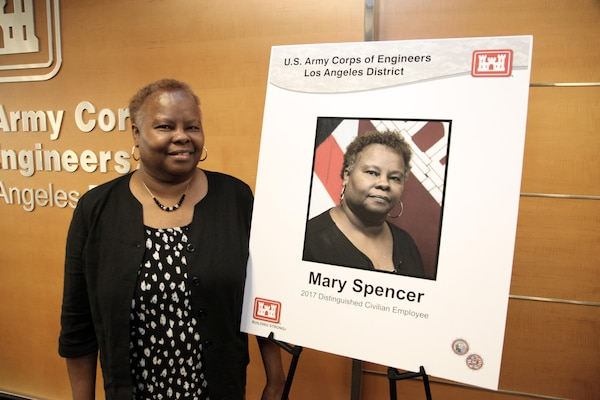 Mary Spencer, former Small Business Program manager, is inducted into the Los Angeles District's Gallery of Distinguished Civilian Employees in a ceremony at the District headquarters in Los Angeles March 23. The induction was held in conjunction with the District's annual Retiree Recognition Day.