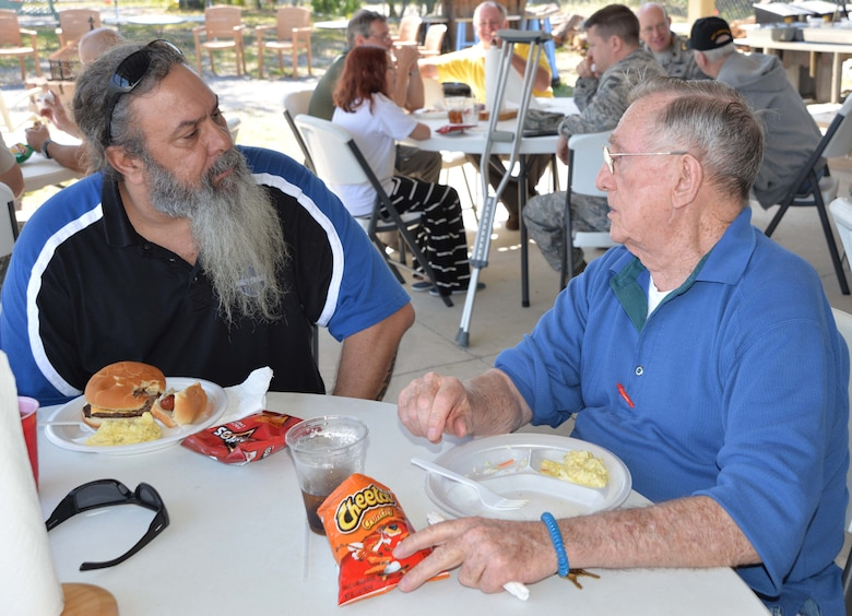 David Shaw, Continental U.S. NORAD Region-1st Air Force (Air Forces Northern) Communication & Information Directorate, talks with John Milan, a resident of the Clifford Chester Sims State Veterans Nursing Home, during a luncheon at American Legion Post 392 in Panama City. Shaw, a Legion member who organized the luncheon, said the event was an opportunity to spend time with the veterans and recognize them for their selfless service and sacrifice. (Photo by Mary McHale)