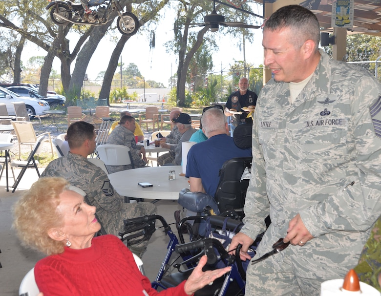 Maxine Mann, a resident of the Clifford Chester Sims State Veterans Nursing Home, talks with Chief Master Sgt. David Little, Senior Enlisted Leader, Continental U.S. NORAD Region-1st Air Force (Air Forces Northern) Communication & Information Directorate, during a luncheon at American Legion Post 392 in Panama City. Event organizer David Shaw, a Legion member from CONR-1st AF (AFNORTH), said the luncheon was an opportunity to spend time with the veterans and recognize them for their selfless service and sacrifice. (Photo by Mary McHale)
