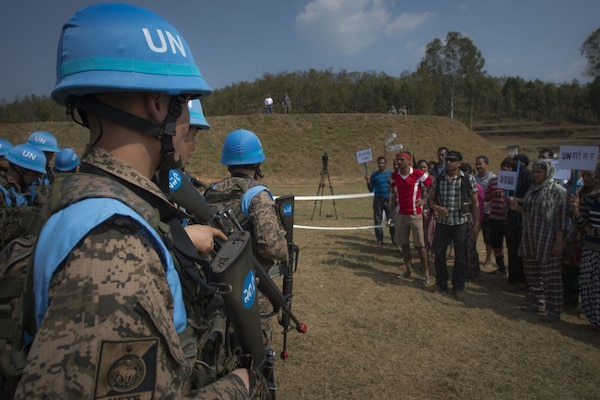 A crowd, acting as protestors, approaches a simulated United Nations camp at exercise Shanti Prayas III in Nepal, Mar. 22, 2017. Shanti Prayas is a multinational U.N. peacekeeping exercise designed to provide pre-deployment training to U.N. partner countries in preparation for real-world peacekeeping operations.