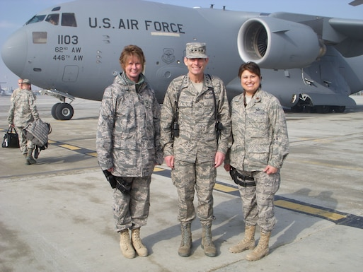 Chief Master Sgt. Milissa Fowler, (left) 153rd Airlift Wing, Force Support Squadron superintendent, and Maj. Nicole Chavez (right), meet Gen. Norton Schwartz, (center) then Chief of Staff of the Air Force, during their support of Operation Enduring Freedom in 2009 where they assisted with protocol. (Courtesy photo)