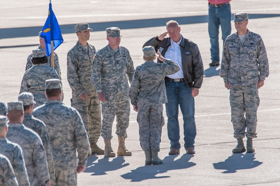 Col. Shelley Campbell, then 153rd Mission Support Group commander and now Chief of the Joint Staff, salutes commander in chief of the Wyoming National Guard, Gov. Matt Mead, during a pass-in-review ceremony at the 153rd Airlift Wing, Cheyenne, Wyoming, July 2015. (Photo by Master Sgt. Charles Delano)