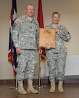 Maj. Gen. Luke Reiner, Wyoming adjutant general, and Brig. Gen. Tammy Maas, assistant adjutant general-Army, celebrate Maas' 30 years of federal technician service at a celebration at the Joint Force Readiness Center, Cheyenne, Wyoming, August 2015. (Photo by Master Sgt. Charles Delano)