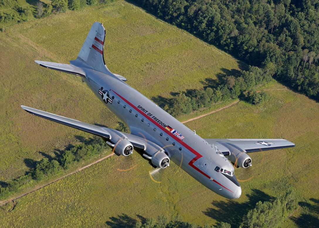 C-54 'Spirit of Freedom' in-flight during a training mission near Warsaw, Indiana in August 2014. The aircraft is owned and operated by the Berlin Airlift Historical Foundation which keeps the aircraft flying and available to the public through important educational outreach and air show appearances. Photo courtesy Greg Morehead.