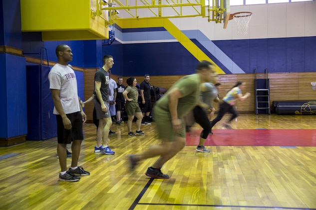 U.S. Marines in the Force Fitness Instructors program do warm-up drills on the final day of an eight-week physical training course at Marine Corps Air Station Iwakuni, Japan, March 17, 2017. These Marines were the first to take the course at MCAS Iwakuni. The recently implemented Force Fitness Instructors are capable of designing individual and unit-level holistic fitness programs, and they serve as subject matter experts on physical fitness and sports-related injury prevention. (U.S. Marine Corps photo by Lance Cpl. Carlos Jimenez)