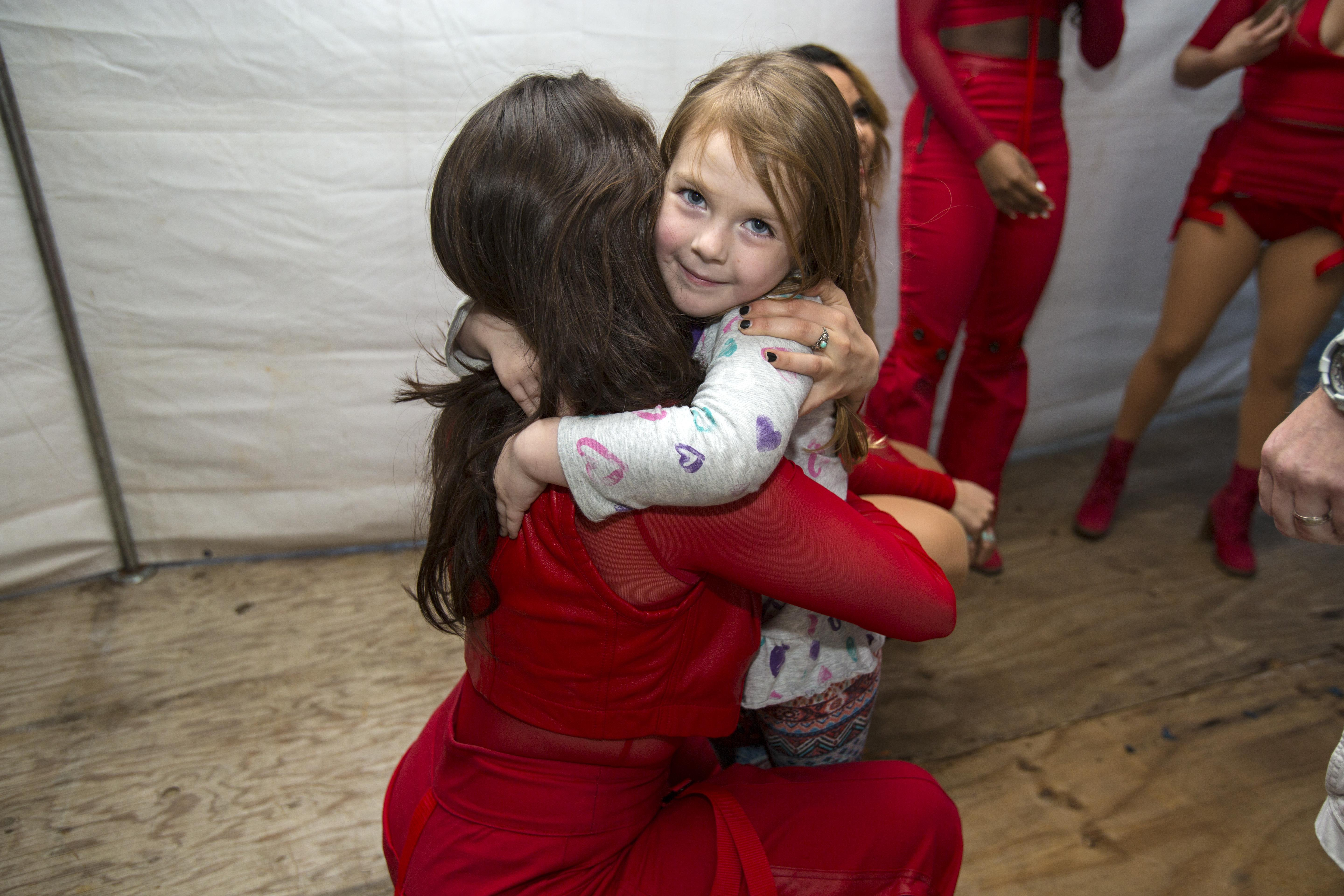 Photos fifth harmony member lauren jauregui hugs a young fan during a meet and greet kristyandbryce Image collections