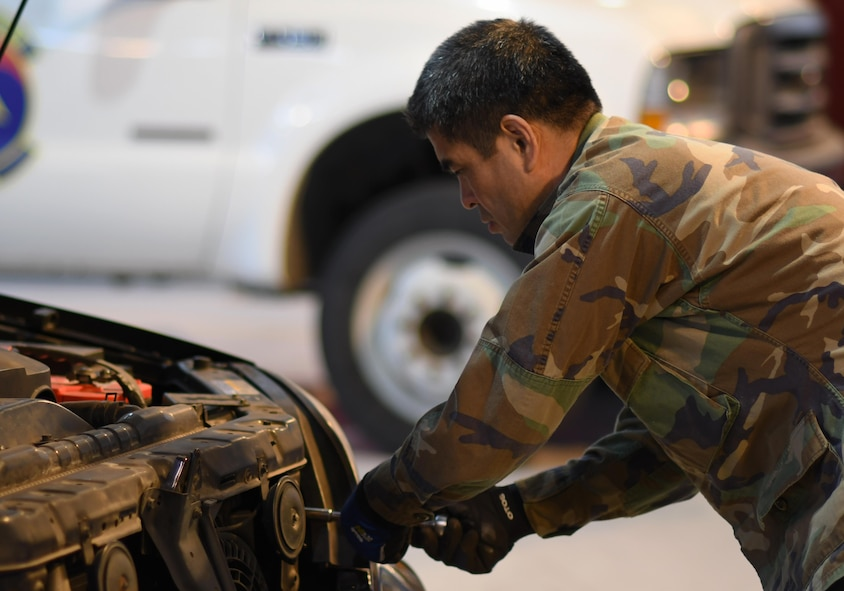 Yi Si-chun, 51st Logistics Readiness Squadron technician, secures a headlight in place at the Vehicle Maintenance Shop on Osan Air Base, Republic of Korea, March 22, 2017. With just over 100 members, Vehicle Maintenance cares for roughly 1,300 vehicles, providing everything from oil changes to engine rebuilds.  (U.S. Air Force photo by Staff Sgt. Alex Fox Echols III/Released)