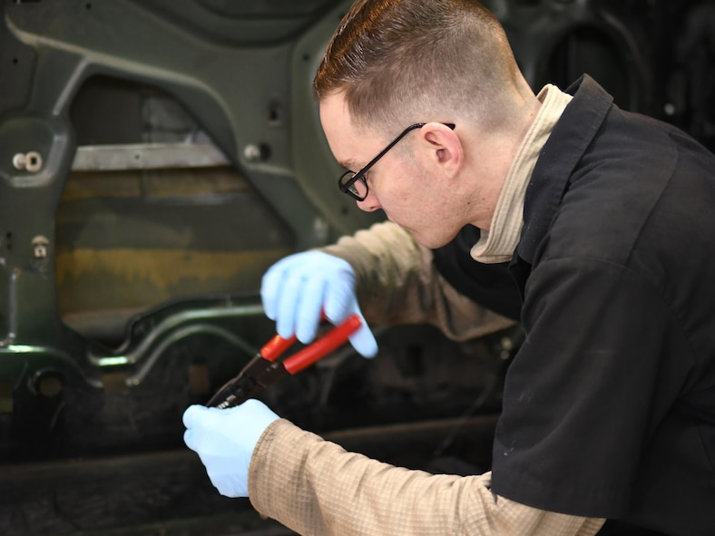 U.S. Air Force Senior Airman Corey Krebs, 51st Logistics Readiness Squadron vehicle maintenance technician, rewires a door sensor connector in the Vehicle Maintenance Shop at Osan Air Base, Republic of Korea, March 23, 2017. With just over 100 members, Vehicle Maintenance cares for roughly 1,300 vehicles, providing everything from oil changes to engine rebuilds.  (U.S. Air Force photo by Staff Sgt. Alex Fox Echols III/Released)