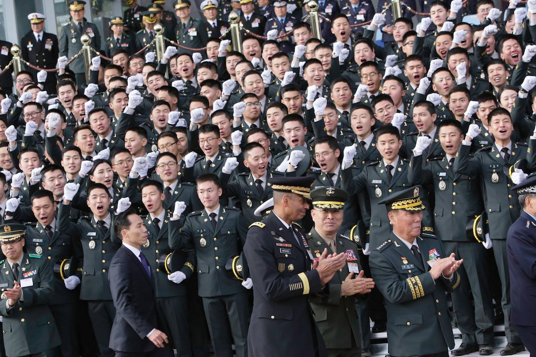 U.S. Forces Korea Commander, Gen. Vincent K. Brooks and Deputy Commander, Combined Force Command, Gen. Leem Ho-young attend the annual Republic of Korea Military Joint Commissioning Ceremony to celebrate more than 5,000 new ROK officers as they receive their commissions on the parade field at Gye-ryong-dae, ROK, March 8.