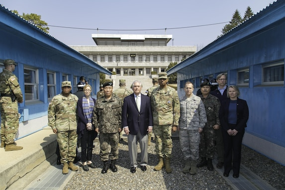 Gen. Vincent K. Brooks, United Nations Commander, Combined Forces Commander, and United States Forces Korea commander, and U.S. Secretary of State Rex Tillerson pose for a photograph with their respective staffs at the Korean border located inside the Joint Security Area(JSA), Mar. 17, 2017. Secretary Tillerson made a stop in Korea during his first visit to Asia as Secretary of State. (U.S. Army photo by SFC Sean K. Harp)