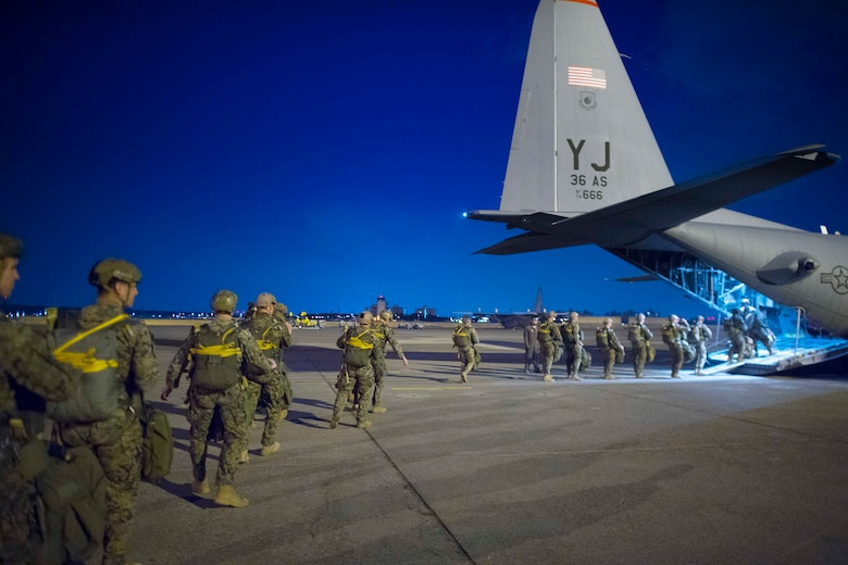U.S. Marines, assigned to the 3rd Reconnaissance Battalion, 3rd Marine Division, 3rd Marine Expeditionary Force, board an Air Force C-130H Hercules during jump week at Yokota Air Base, Japan, March 23, 2017. The training not only allowed the Marines to practice jumping, but it also allowed the Yokota aircrews to practice flight tactics and timed-package drops. (U.S. Air Force photo by Yasuo Osakabe)