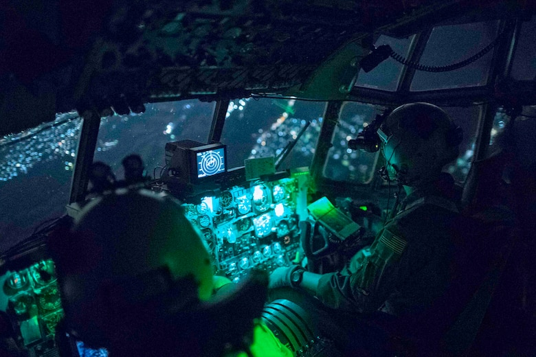 (Right to left) Capt. Travis Wilkes, 374th Operations Group C-130 flight commander, and Capt. Jeremy Sarro, 36th Airlift Squadron C-130 pilot, wear night vision goggles during jump week over Yokota Air Base, Japan, March 23, 2017. The training not only allowed the Marines to practice jumping, but it also allowed the Yokota aircrews to practice flight tactics and timed-package drops. (U.S. Air Force photo by Yasuo Osakabe)