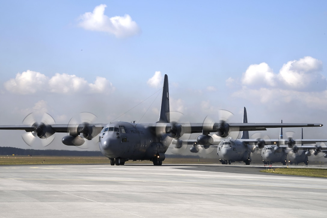 U.S. and Polish C-130 Hercules aircraft prepare to fly a 4-ship formation at Powidz Air Base, Poland, March 24, 2017.  Airmen from both countries participated in bilateral training during Aviation Detachment 17-2 in support of Operation Atlantic Resolve.  These bilateral trainings focused on maintaining joint readiness while building interoperability.  (Air National Guard photo by Staff Sgt. Alonzo Chapman/Released).