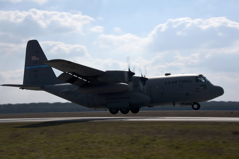 A U.S. C-130 Hercules conducts a tactical landing at Powidz Air Base, Poland, March 24, 2017.  Airmen from the U.S. and Poland participated in bilateral training during Aviation Detachment 17-2 in support of Operation Atlantic Resolve.  These bilateral trainings focused on maintaining joint readiness while building interoperability.  (Air National Guard photo by Staff Sgt. Alonzo Chapman/Released).