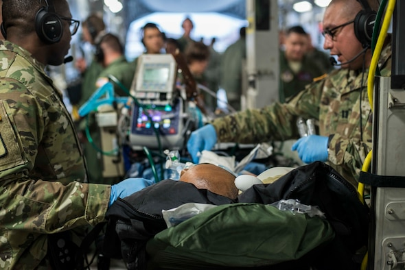 A patient lays on a gurney in a C-17 Globemaster III during an aeromedical evacuation at Misawa Air Base, Japan, March 22, 2017. Airmen and Soldiers, along with U.S. and Japanese Civilian personnel from six different locations around the world, teamed up to provide the largest aeromedical evacuation ever at Misawa AB. (U.S. Air Force photo/Senior Airman Brittany A. Chase)