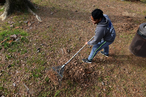 U.S. Air Force Airman 1st Class Kathleen Brown, 609th Air Communications Squadron cyber system operator, rakes up leaves during the ninth annual Beautify Wateree event at Wateree Recreation Area near Camden, S.C., March 25, 2017. The event provided an opportunity for Team Shaw members to take ownership of the campgrounds and clear them of debris after the winter season. (U.S. Air Force photo by Airman 1st Class Destinee Sweeney)