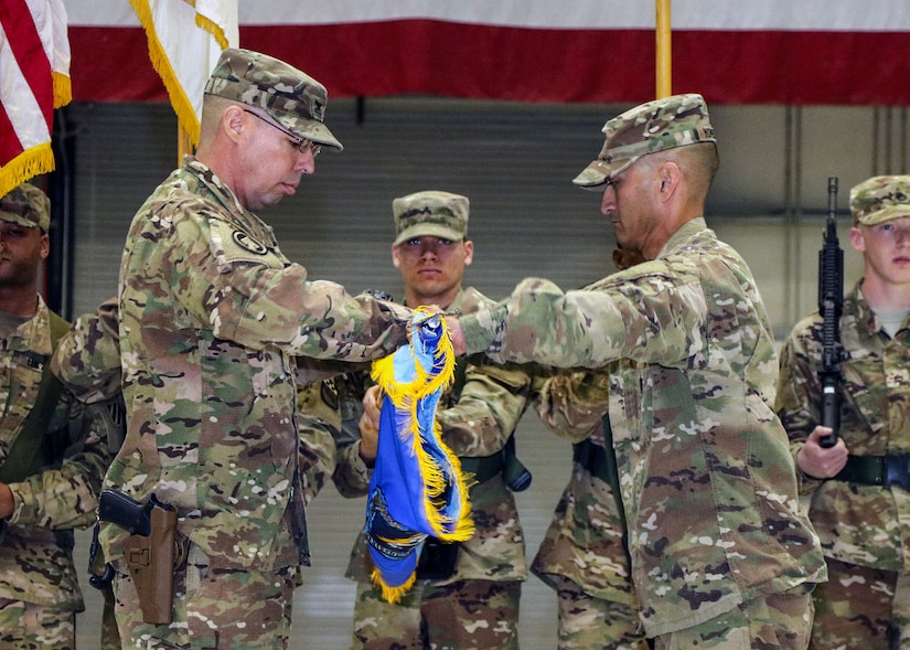 BAGRAM AIRFIELD, Afghanistan (Mar. 26, 2017) - U.S. Army Col. Mark A. Colbrook and Command Sgt. Maj. Lee K. Yoneyama case the Task Force ODIN unit colors during the transfer of authority ceremony held here today.  TF ODIN transferred the Afghanistan-theater Intelligence, Surveillance, and Reconnaissance mission to TF Lightning (525th E-MIB). Colbrook and Yoneyama are the TF ODIN commander and command sergeant major.